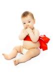 阻塞的婴孩逗人喜爱的红色丝带 库存照片