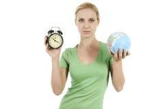 阻止苏醒妇女年轻人的alarma地球 免版税图库摄影
