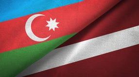 阿塞拜疆和拉脱维亚两旗子纺织品布料,织品纹理 皇族释放例证