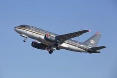 阿姆斯特丹史基浦机场-约旦皇家航空空中客车A319离开 免版税图库摄影