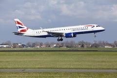 阿姆斯特丹史基浦机场-英国航空公司巴西航空工业公司190土地 图库摄影