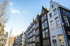 阿姆斯特丹在太阳集合时间的市中心著名大厦和地方  一般风景视图 图库摄影