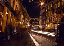 阿姆斯特丹,荷兰- 2016年1月22日:阿姆斯特丹城市街道在晚上 城市全视图环境美化2016年1月22日 免版税库存图片