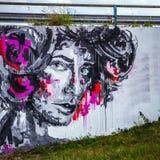 阿姆斯特丹,荷兰- 2016年8月15日:面孔的艺术图象在街道墙壁上的 阿姆斯特丹-荷兰 库存照片