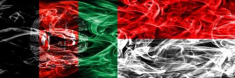 阿富汗对印度尼西亚肩并肩被安置的烟旗子 浓厚 皇族释放例证