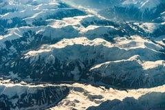 阿尔卑斯在日出期间的冬天从空气 免版税图库摄影