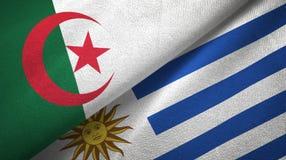 阿尔及利亚和乌拉圭两旗子纺织品布料,织品纹理 皇族释放例证