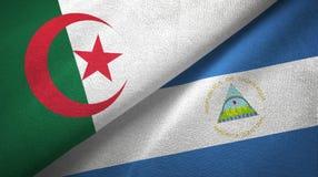 阿尔及利亚和尼加拉瓜两旗子纺织品布料,织品纹理 皇族释放例证