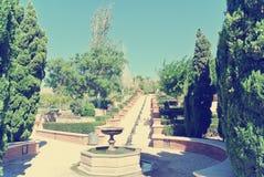 阿尔梅里雅Alcazaba庭院在一个晴天;减速火箭的样式 免版税库存照片