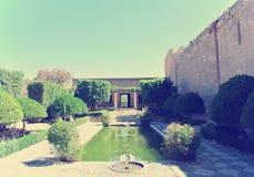阿尔梅里雅Alcazaba庭院在一个晴天;减速火箭的样式 库存照片