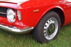 阿尔法・罗密欧车灯和轮胎 免版税库存照片