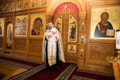 阿尔玛蒂,哈萨克斯坦- 12月17 :2013年12月17日的洗礼仪式仪式在阿尔玛蒂,哈萨克斯坦。 免版税图库摄影