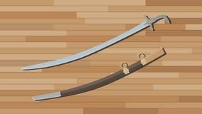 阿拉伯剑有木桌背景 库存照片
