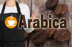 阿拉伯咖啡概念由咖啡烘烤器显示 免版税库存图片