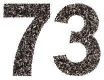 阿拉伯数字73,七十三,从黑色一块自然木炭, 免版税库存照片