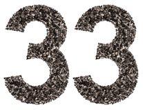 阿拉伯数字33,三十三,从黑色一块自然木炭, 免版税库存图片