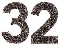 阿拉伯数字32,三十二,从黑色一块自然木炭,是 免版税库存图片