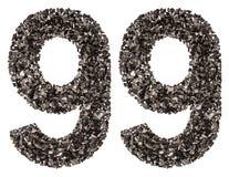 阿拉伯数字99,九十九,从黑色一块自然木炭, i 免版税图库摄影