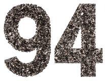 阿拉伯数字94,九十四,从黑色一块自然木炭, i 免版税库存照片