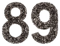 阿拉伯数字89,八十九,从黑色一块自然木炭, i 免版税库存图片