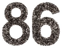 阿拉伯数字86,八十六,从黑色一块自然木炭,是 免版税库存图片