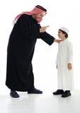 阿拉伯父亲穆斯林儿子 免版税图库摄影