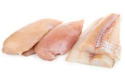 阿拉斯加狭鳕和鸡胸脯内圆角  库存照片