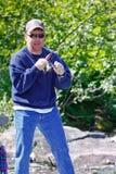 阿拉斯加-红鲑鱼的人捕鱼 库存图片