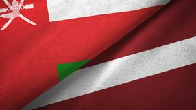 阿曼和拉脱维亚两旗子纺织品布料,织品纹理 向量例证