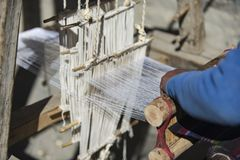 阿曼织布工在尼泊尔, Manang野马喜马拉雅山城市, 12月201 库存图片