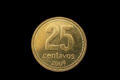 阿根廷金子在黑色隔绝的二十五分硬币 库存图片