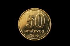 阿根廷金子在黑色隔绝的五十分硬币 免版税库存图片