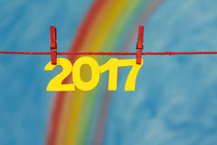 2017除夕编号与彩虹和天空 免版税库存照片