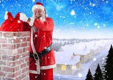 去除礼物大袋的圣诞老人从烟囱 库存图片