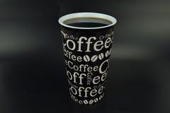 陶瓷杯子用充分书面的咖啡 图库摄影