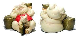 陶瓷猪中国幸运的金钱 免版税库存图片