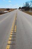隆隆声小条被刻记入一条次要高速公路 免版税图库摄影