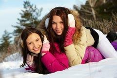 随风飘飞的雪的女孩 图库摄影