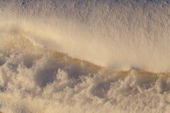 随风飘飞的雪的表面,冬天 免版税库存照片