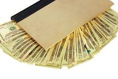 隐藏空心货币的书 库存照片