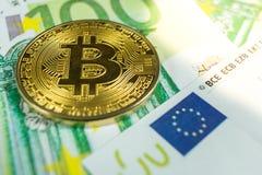 隐藏货币概念-与欧元票据的一bitcoin 库存图片
