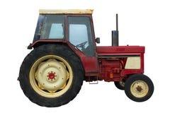 隔离红色生锈的拖拉机 免版税库存图片