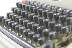 隔绝在葡萄酒打字机的白色细节 库存照片