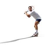 隔绝在白年轻人打网球 免版税库存照片