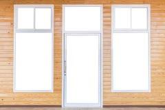 隔绝门和窗架在明亮的杉木木墙壁上 图库摄影