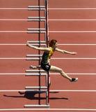 障碍妇女奔跑轨道 免版税库存照片