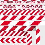 障碍磁带 红色和白色限制性磁带 免版税库存照片