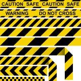 障碍磁带 黄色和黑限制性磁带 库存照片