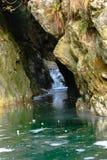 隧道小河通过岩石 库存图片