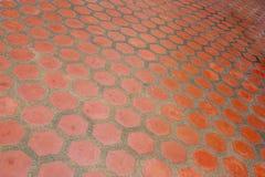 难倒桔子的陶瓷砖 免版税库存照片